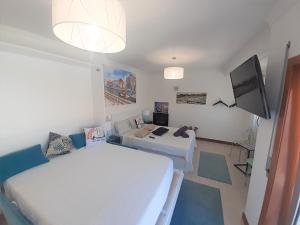 Uma cama ou camas num quarto em Aveiro Central - It´s ALL there - 2
