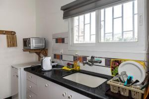 A kitchen or kitchenette at David Hostel