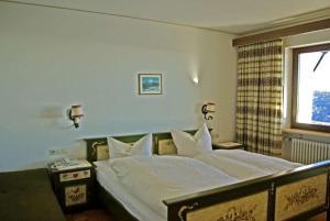 Ein Bett oder Betten in einem Zimmer der Unterkunft Panoramahotel Alde Hotz GbR