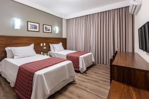Кровать или кровати в номере Hotel Bahia do Sol