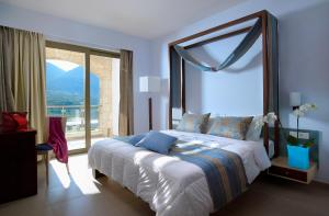 A bed or beds in a room at Filion Suites Resort & Spa