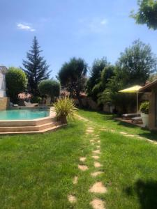 The swimming pool at or close to Au sommeil du lion