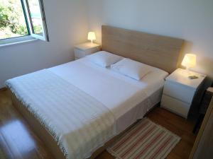 Letto o letti in una camera di Apartment Karmelo