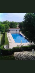 The swimming pool at or near Parador de Manzanares