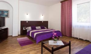Кровать или кровати в номере Penzion U Králíků
