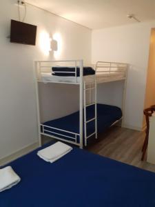 A bunk bed or bunk beds in a room at Hôtel Croix des Nordistes