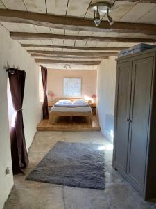 Un ou plusieurs lits dans un hébergement de l'établissement La Bugadière