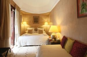 Ein Bett oder Betten in einem Zimmer der Unterkunft Riad Samsara