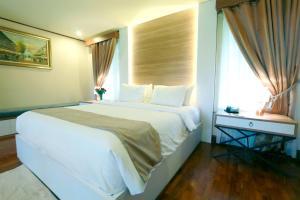 Cama o camas de una habitación en R Hotel Rancamaya