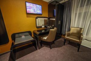Een TV en/of entertainmentcenter bij Hotel Mansion