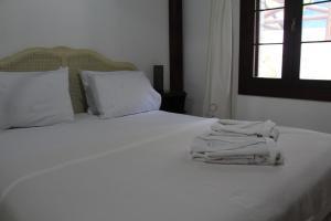 Кровать или кровати в номере Yalicapkini Boutique Hotel