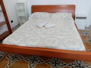 A bed or beds in a room at Guesthouse City Center