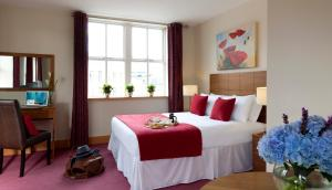 Un ou plusieurs lits dans un hébergement de l'établissement Beresford Hotel