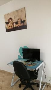 A television and/or entertainment center at Fortuna Suites