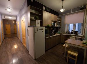 Кухня или мини-кухня в Ель Хостел и Кофейня