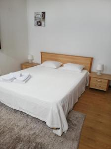 A bed or beds in a room at casa cardeal saraiva