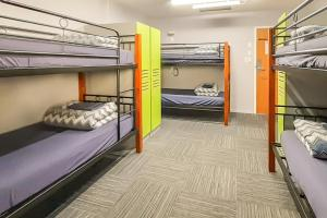 A bunk bed or bunk beds in a room at YHA Franz Josef