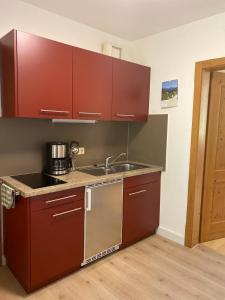 A kitchen or kitchenette at Ferienwohnungen Wendelstein