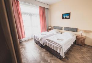 Posteľ alebo postele v izbe v ubytovaní Cybulskiego Guest Rooms