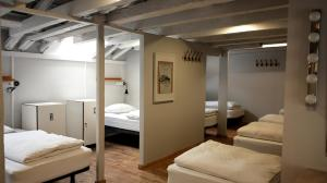 A bed or beds in a room at Goodmorning Solo Traveller Hostel