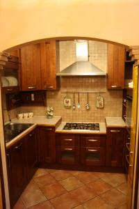 A kitchen or kitchenette at Bed And Breakfast Mblò
