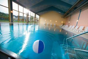 The swimming pool at or near JUFA Hotel Vulkanland