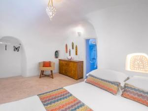 A bed or beds in a room at Anemi House & Villas
