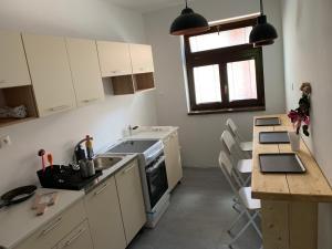 Kuchyňa alebo kuchynka v ubytovaní PINK Apartment