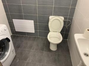 Kúpeľňa v ubytovaní PINK Apartment