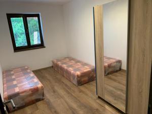 Posteľ alebo postele v izbe v ubytovaní PINK Apartment