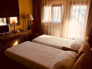 Cama o camas de una habitación en Hotel Rural Spa & Wellness Hacienda Los Robles