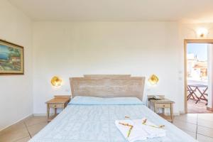 Een bed of bedden in een kamer bij Hotel Bonsai