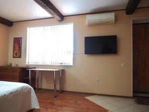 Телевизор и/или развлекательный центр в apartment na Zavetnoi