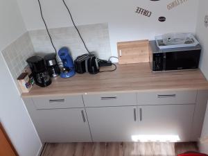 A kitchen or kitchenette at Gästehaus Strudthoff