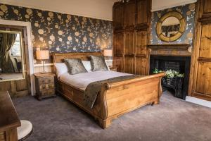 A bed or beds in a room at Shibden Hall View