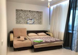 Гостиная зона в Apartments on Vera Zasulich 48