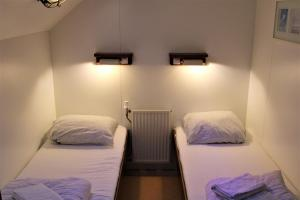 A bed or beds in a room at Felicitas