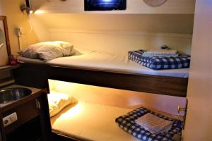 A bunk bed or bunk beds in a room at Passengership Avanti