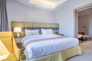 سرير أو أسرّة في غرفة في ايوا اكسبريس - بريدة
