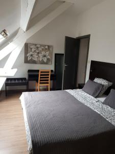 A bed or beds in a room at Appartements Bon Secours