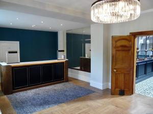The lobby or reception area at Best Western Chilworth Manor Hotel