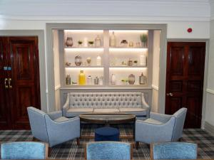 A seating area at Best Western Chilworth Manor Hotel