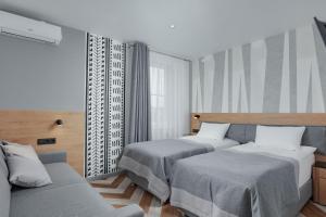 Кровать или кровати в номере Всесезонный курорт Манжерок