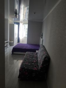 Кровать или кровати в номере Apartment Svetlana