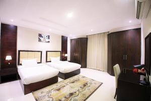 Cama ou camas em um quarto em Asdaa Al Rahah Hotel Suites
