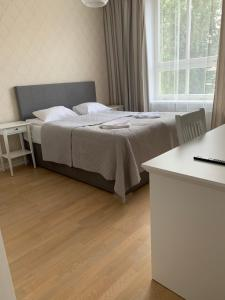 Voodi või voodid majutusasutuse Rohuaia Apartments toas
