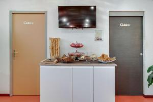 A kitchen or kitchenette at Residhotel Le Central'Gare