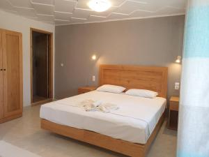 A bed or beds in a room at Apartments Xenophon