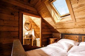 A bed or beds in a room at Steirisch Ursprung