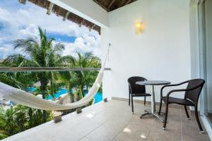 A view of the pool at Secrets Aura Cozumel - Adults Only or nearby